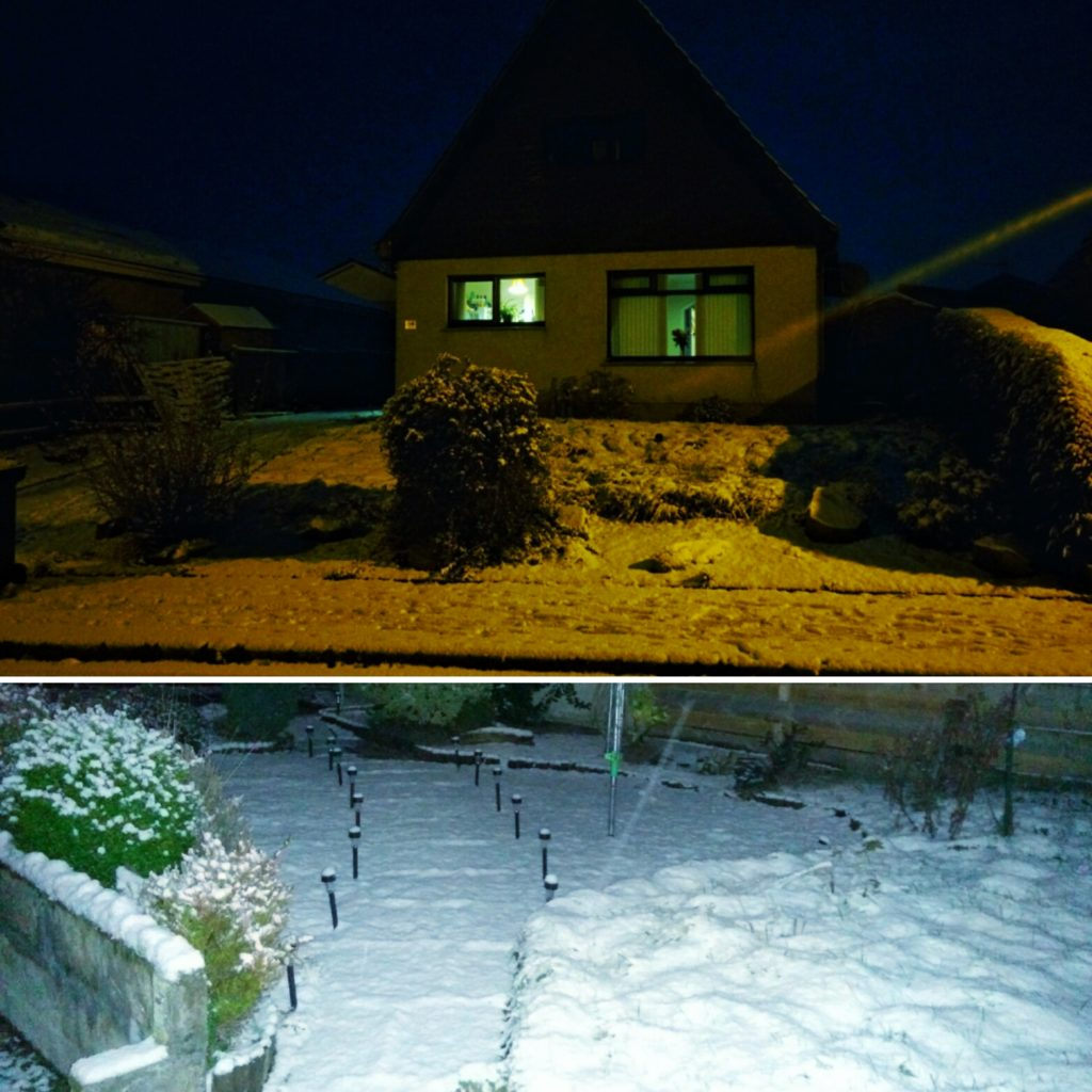 A house with a snow-covered garden in Scotland.