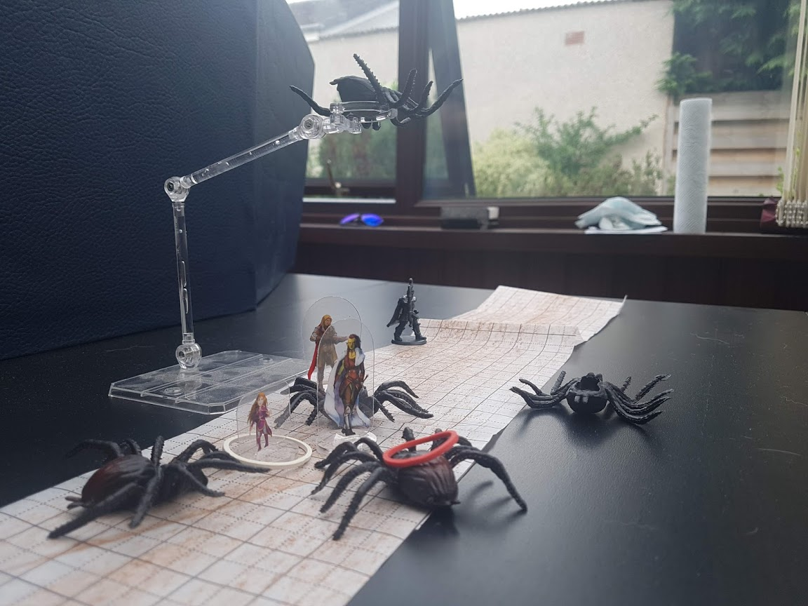 A Dungeons and Dragons battle with four players against five spiders.