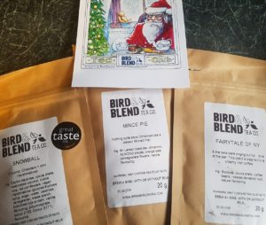Tea club subscription set of wintery teas. Three tea packs: mince pie flavour, snowball (chocolate coconut) flavour, Fairytale of NY (coffee flavour).