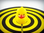 yellow bath duck toy on a target board